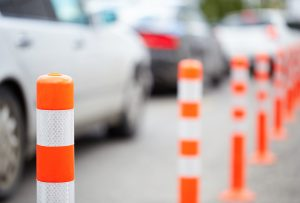 Dollarphotoclub 67404700 300x203 - Orange bollard on the road. Traffic jam.